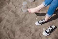 Clean beauty white foot lady sit on sandy beach Royalty Free Stock Images