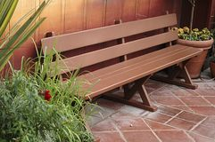 Clean bench outdoors. Nice bench and colors. Outside picture, with plants for contrast Royalty Free Stock Photos
