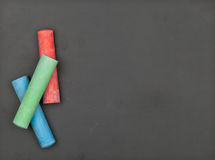 Clean blackboard with colorful chalk Stock Photography