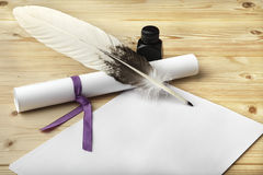 A clean of blank paper, a scroll, a goose feather, and a black ink bottle are located on a wooden table. Royalty Free Stock Photos