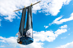 Clean Blue Jeans. Blue jeans hung to dry in the sky Royalty Free Stock Photos