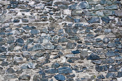 Clean bluish stones in a wall. Stone wall composed of blue-colored stones royalty free stock image