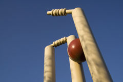 Clean bowled. Cricket stumps shattered by the new ball Royalty Free Stock Images