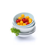 Clean bowls, assorted fresh cherry tomatoes, parsley, isolated Royalty Free Stock Photos