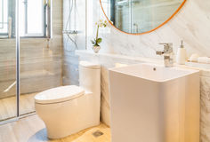 Clean and bright bathroom. Washbasin and toilet Royalty Free Stock Photos