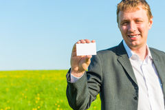 Clean business card in hand of a  businessman Royalty Free Stock Photo