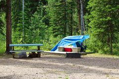 A clean campsite and items stowed away for the daytime Stock Image