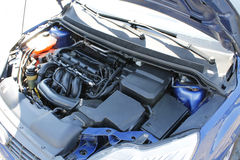 Clean car engine under the open hood. Engine bay with open hood. The engine of this car is very clean royalty free stock photos