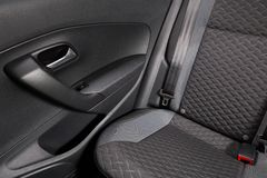 Clean car interior. Back seat of a modern car with a new upholstery royalty free stock photo