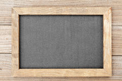 Clean chalkboard on wooden table Royalty Free Stock Photography