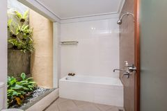 Clean and Cheap hotel bathroom stock images