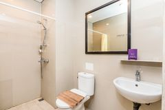 Clean and Cheap hotel bathroom stock image