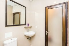 Clean and Cheap hotel bathroom stock photography