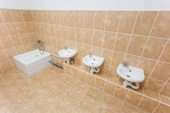Clean children washroom with sinks and water-closet in kindergarten stock photos