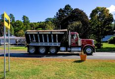 Large, commercial dumper trunk seen in a US town. This clean, chrome plated truck is used for carry aggregates and other construction materials stock photos