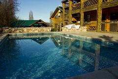 Clean, clear, blue water in the pool on the territory of the cottage stock image
