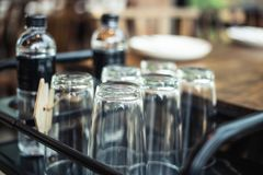 Clean and clear water glasses prepare at table side in restaurant royalty free stock images