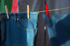 Clean clothes drying on a rope.  Stock Photos