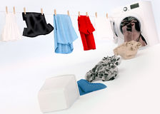 Clean clothing hanging on a rope coming out of the washing machi Royalty Free Stock Image