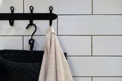 Clean Colored towels hanging on the rack in the bathroom. Focus on the top of the hook and towels stock photos