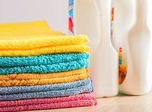 Clean, colorful, folded clothes. Means for washing clothes. stock photos