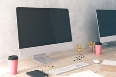 Clean computer displays on desk side Stock Photo