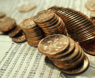 Clean copper coins. And finanical stock and shares information Royalty Free Stock Photography