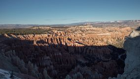 Orange Sunset over Bryce Canyon National Park. Clean, crisp, shadows roll over Bryce Canyon at Sunset. This is a time-lapse shot mounted to a slider stock footage