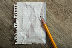 Clean crumpled sheet with pencil Stock Photo