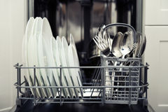 Clean cutlery and plates Stock Photos