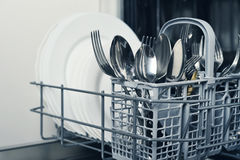 Clean cutlery and plates Royalty Free Stock Photos