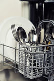 Clean cutlery and plates Royalty Free Stock Images