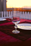 Clean cutlery on the serving table at sunset before dinner Royalty Free Stock Photo