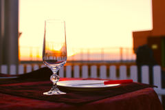 Clean cutlery on the serving table at sunset before dinner Stock Image