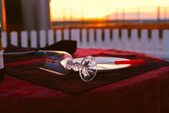 Clean cutlery on the serving table at sunset before dinner Royalty Free Stock Photography