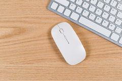 Clean desktop with keyboard and mouse on red oak surface Royalty Free Stock Photography