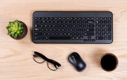 Clean desktop setup with modern wireless computer keyboard Royalty Free Stock Photo