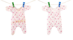 Clean and dirty baby cloth. Set of clean and dirty baby cloth hanging on rope isolated Stock Photography