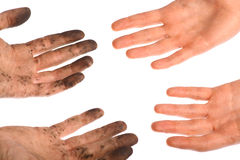 Clean dirty hands. Two hands are dirty, two hands are clean Stock Photography