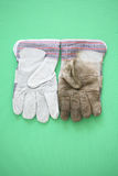 Clean and dirty work gloves Royalty Free Stock Photo