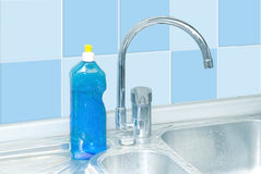 Clean dish washer. Blue dish washer on kitchen with cleaner, tap, tile water drops Stock Photo