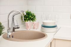 Clean dishes on counter near kitchen sink. Indoors royalty free stock images