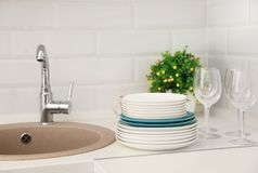 Clean dishes on counter near kitchen sink. Indoors royalty free stock photo