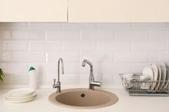Clean dishes on counter near kitchen sink. Indoors royalty free stock photos