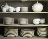 Clean Dishes, Cups & Tableware. Placed on a wooden shelves Royalty Free Stock Photos