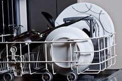 Clean dishes in dishwasher. Clean dishes in the dishwasher Stock Images