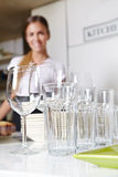 Clean dishes in kitchen. With smiling female kitchen staff Royalty Free Stock Photography
