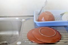 Clean dishes put near the sink. Stock Photo