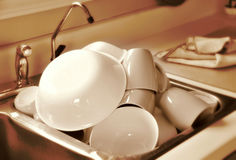 Clean dishes in sink. Clean dishes draining in sink Royalty Free Stock Photography