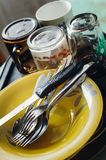 Clean dishes on table - fork, spoon and knife stock photography